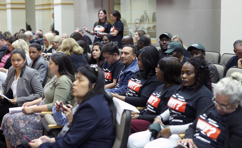 Parkland family members wait their turn to speak at a Senate Rules Committee meeting concerning Gov. Ron DeSantis' dismissal of Broward County Sheriff Scott Israel, Monday Oct. 21, 2019, in Tallahassee, Fla. (AP Photo/Steve Cannon)