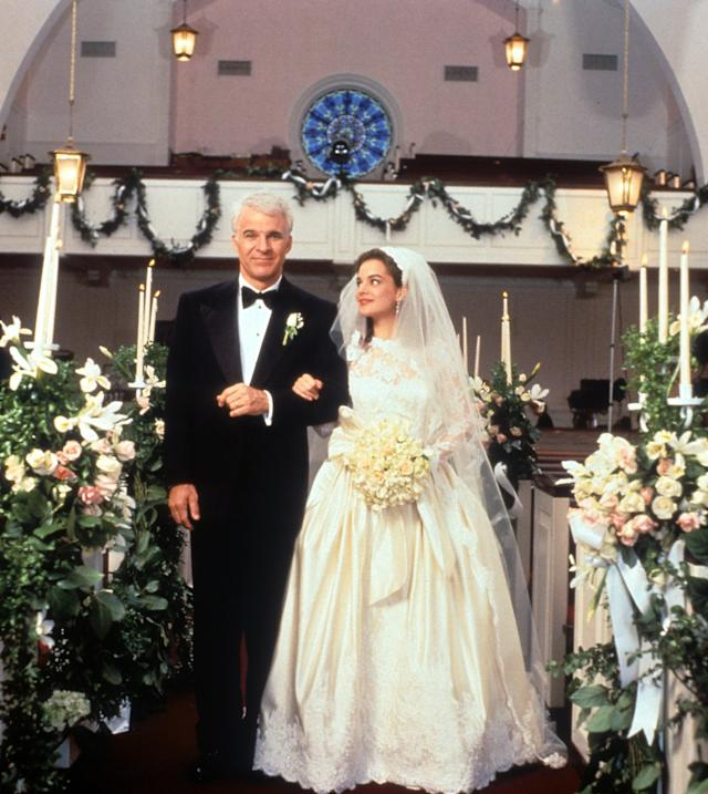 Steve Martin walking down the aisle with Kimberly Williams-Paisley in a scene from the film 'Father Of The Bride', 1991. (Photo by Touchstone/Getty Images)