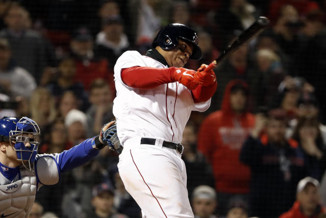 Boston Red Sox's Rafael Devers follows through on his walk-off single against the Toronto Blue Jays during the ninth inning of a baseball game Thursday, April 11, 2019, at Fenway Park in Boston. Boston won 7-6. (AP Photo/Winslow Townson)