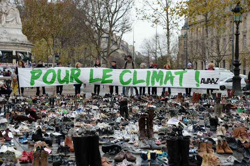 The Place de la Republique in Paris, covered by hundreds of pairs of shoes on November 29, 2015 in a climate rally, one way to get around the ban on public gatherings after the terror attacks (AFP Photo/Miguel Medina)