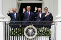 US President Donald Trump is flanked by Israeli Prime Minister Benjamin Netanyahu and the foreign ministers of Bahrain and the United Arab Emirates as they sign a landmark normalization accord on September 15, 2020