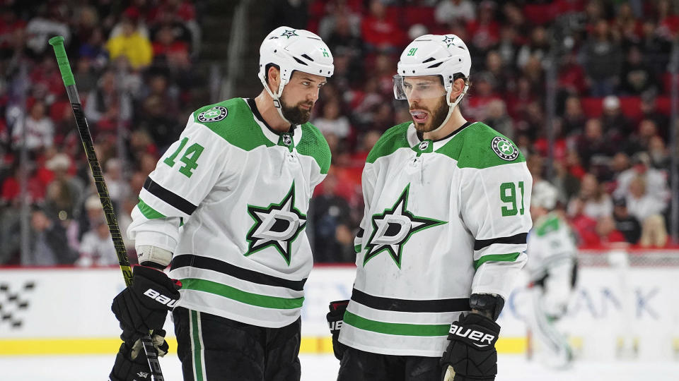 Feb 25, 2020; Raleigh, North Carolina, USA; Dallas Stars center Tyler Seguin (91) and  left wing Jamie Benn (14) talks against the Carolina Hurricanes at PNC Arena. The Dallas Stars defeated the Carolina Hurricanes 4-1. Mandatory Credit: James Guillory-USA TODAY Sports - 14098041