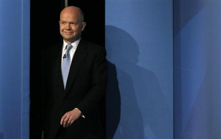 Britain's Foreign Secretary Hague walks on stage ahead of his keynote address on the opening day of The Conservative Party annual conference in Manchester