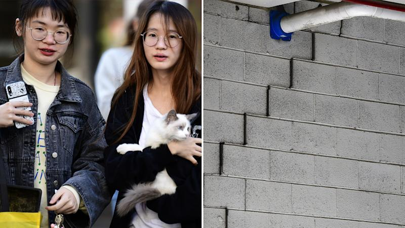 Pictured left are residents leaving Mascot Towers holding their belongings and pet cat. On the right is a large crack shown on a wall of the building.