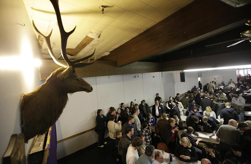 A mounted Elk head is shown as voters take part in discussions during a Washington state caucus meeting, Saturday, March, 3, 2012, at an Elks Club in Puyallup, Wash. Thousands of Republican voters crowded schools, town halls and homes across the state Saturday for Washington's GOP presidential caucuses, the first meaningful party contests in the state in recent memory. (AP Photo/Ted S. Warren)