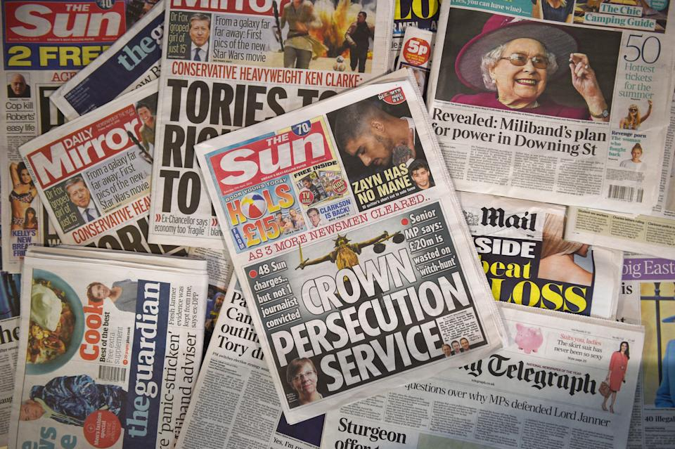 """A picture taken in London on April 18, 2015 shows an arrangement of British newspapers and an edition of the Sun newspaper carrying a front page story about the collapse of prosecutions by the Crown Prosecution Service (CPS) under the police's Operation Elveden.  Villified for their dark arts since the phone-hacking scandal, Britain's popular press won a victory this week after prosecutors acknowledged that the long-held practice of paying sources for stories was legitimate. Paying for stories has long been common in the British media, and many of the journalists prosecuted said they had no idea they might have been committing a crime. Britain's top-selling newspaper, The Sun, has said there was a """"witch-hunt"""" against its journalists and in a front page Saturday condemned the """"Crown Persecution Service"""".  AFP PHOTO / DANIEL SORABJI        (Photo credit should read DANIEL SORABJI/AFP/Getty Images)"""