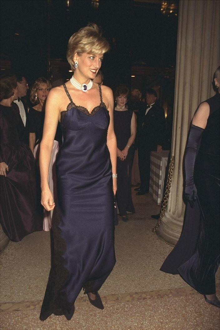 """<p>Princess Diana's fashion choices became bolder after she divorced Prince Charles. Case in point: The satin and lace Dior slip dress she wore to the 1996 Met Gala. Diana reportedly <a href=""""https://www.elle.com/uk/fashion/celebrity-style/a26340204/princess-diana-almost-didnt-wear-iconic-navy-dior-slip-dress-for-fear-of-embarrassing-prince-william/"""" rel=""""nofollow noopener"""" target=""""_blank"""" data-ylk=""""slk:almost didn't wear the design"""" class=""""link rapid-noclick-resp"""">almost didn't wear the design</a> so she wouldn't offend her son, Prince William. Thankfully for us, and the rest of the fashion world, she did. </p>"""