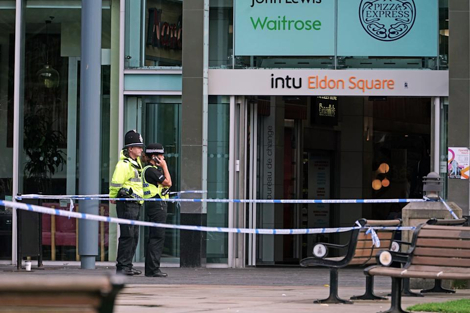Police officers outside a branch of Greggs near Old Eldon Square, Newcastle, where a 52-year-old man was assaulted on Wednesday and later died in hospital.