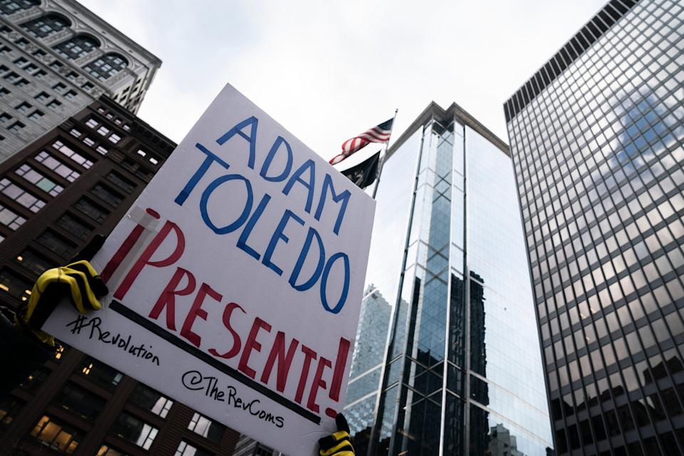 Demonstrators gather in Freedom Plaza in downtown demanding justice for 13-year-old Adam Toledo, who was killed last month by a Chicago police officer on April 14, 2021.