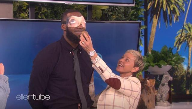 "<a class=""link rapid-noclick-resp"" href=""/nba/players/3704/"" data-ylk=""slk:LeBron James"">LeBron James</a> completes a dare with Ellen DeGeneres involving a blindfold and kiwi during her show Wednesday, Sept. 12. James and Channing Tatum raised $100,000 for James' I Promise School."