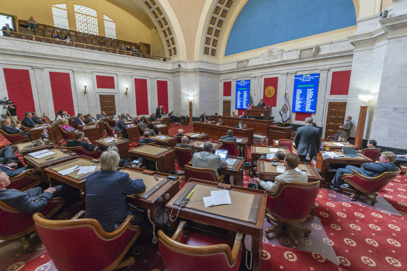 FILE - In this Monday, Aug. 20, 2018, file photo, the state Senate convenes a special session to begin impeachment proceedings against several state Supreme Court Justices. Twenty candidates are running for two Supreme Court seats in West Virginia, where four justices were impeached by the Republican House following questions about costly renovations that evolved into accusations of corruption, incompetence and neglect of duty. (Craig Hudson/Charleston Gazette-Mail via AP, File)