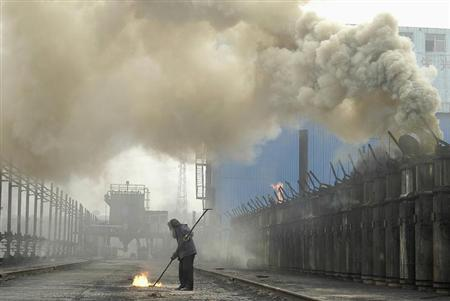 Labourer works at a coking plant in Changzhi