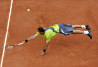 FILE - In this May 30, 2007, file photo, Russia's Marat Safin reaches for the ball as he plays Serbia's Janko Tipsarevic in their second round match of the French Open tennis tournament at Roland Garros stadium in Paris. (AP Photo/Lionel Cironneau, File)