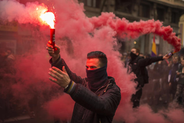 <p>Students march and light flares during the second day of a student strike in Madrid Feb. 26, 2015. Students across Spain protested changes in the system of university degrees. (AP Photo/Andres Kudacki) </p>