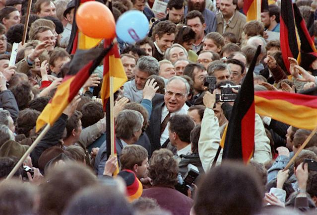<p>West German Chancellor Helmut Kohl moves through a crowd of supporters February 20,1990 during his first appearance as part of the East German election campaign in Erfurt, East Germany. (REUTERS/Reinhard Krause) </p>