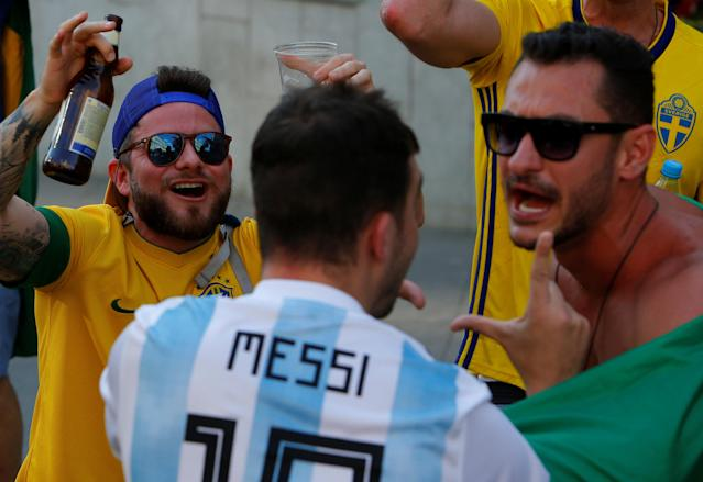 Brazil fans talk to a supporter of Argentina soccer team as they celebrate Brazil's victory over Costa Rica at the World Cup Group E soccer match in central Moscow, Russia June 22, 2018. REUTERS/Sergei Karpukhin