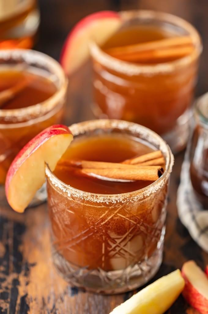 """<p>We're drooling over Massachusetts' drink choice. In this recipe, the typical old fashioned gets an upgrade thanks to the addition of apple butter, apple cider, and cinnamon sticks. Yum!</p> <p><strong>Get the recipe</strong>: <a href=""""https://www.popsugar.com/buy?url=https%3A%2F%2Fwww.thecookierookie.com%2Fapple-butter-old-fashioned%2F&p_name=apple%20butter%20old%20fashioned&retailer=thecookierookie.com&evar1=yum%3Aus&evar9=47471653&evar98=https%3A%2F%2Fwww.popsugar.com%2Ffood%2Fphoto-gallery%2F47471653%2Fimage%2F47474376%2FMassachusetts-Old-Fashioned&list1=cocktails%2Cdrinks%2Calcohol%2Crecipes&prop13=api&pdata=1"""" class=""""link rapid-noclick-resp"""" rel=""""nofollow noopener"""" target=""""_blank"""" data-ylk=""""slk:apple butter old fashioned"""">apple butter old fashioned</a></p>"""