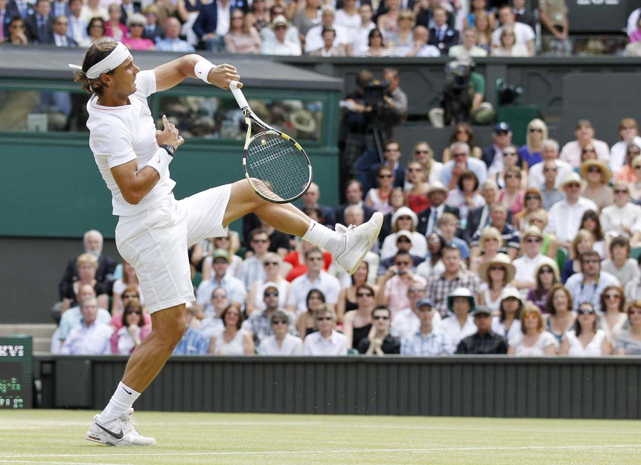 Spain's Rafael Nadal makes a overhead smash return to Tomas Berdych of the Czech Republic during the men's single's finalat the All England Lawn Tennis Championships at Wimbledon, Sunday, July 4, 2010. (AP Photo/Anja Niedringhaus)