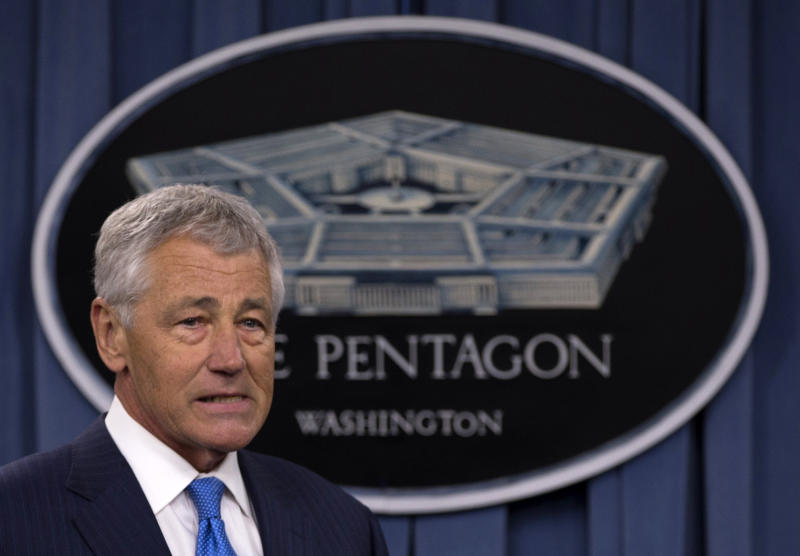 FILE - In this March 1, 2013 file photo, Defense Secretary Chuck Hagel arrives at a news conference at the Pentagon. A case involving an Air Force general who dismissed charges against a lieutenant colonel convicted of sexual assault will be reviewed at the top levels of the Pentagon, Defense Secretary Chuck Hagel said in a letter released Monday. But it seemed unlikely that the ruling would be changed. (AP Photo/Carolyn Kaster, File)