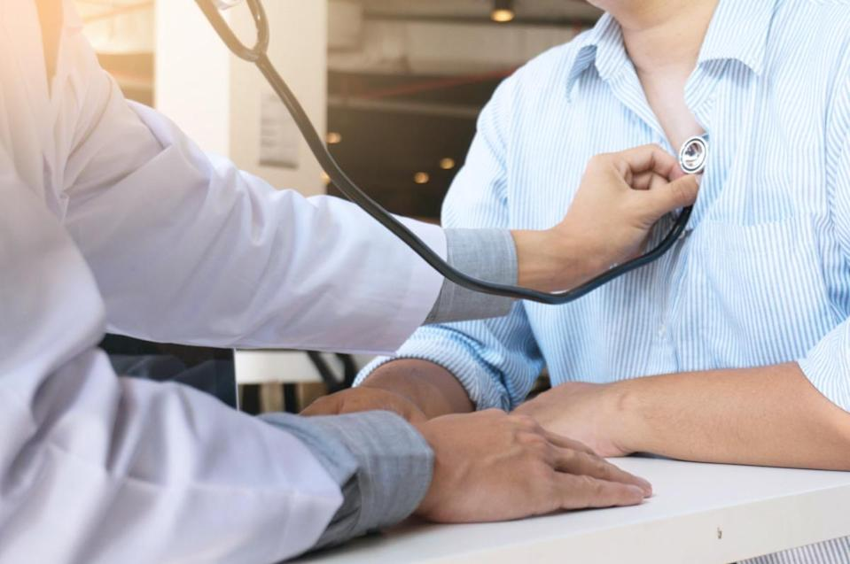 Doctor checks the patient's chest.