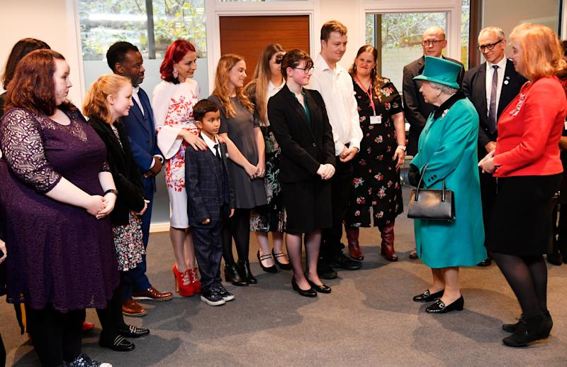 Adorable moment shy boy crawls away when he meets the Queen