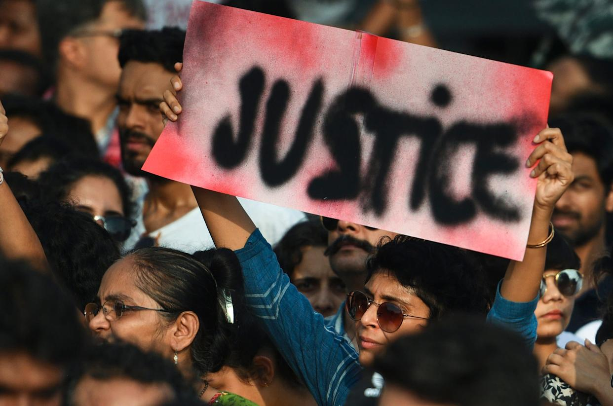 People holdsigns as they participate in a protest against the Kathua, Unnao, rape cases and other incidents of rape in India on April 15, 2018 in Mumbai, India. (Photo: Hindustan Times via Getty Images)