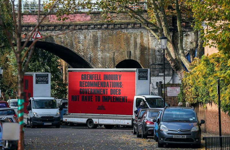 Three billboards by Campaign group Justice4Grenfell drive to and from Grenfell Tower in west London on the day the first report from the public inquiry into the fire which claimed 72 lives is published (PA)