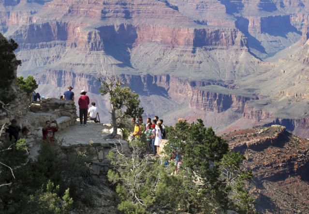 Visitors at an outlook on the South Rim of Grand Canyon National Park in Arizona. (Photo: Felicia Fonseca/AP)