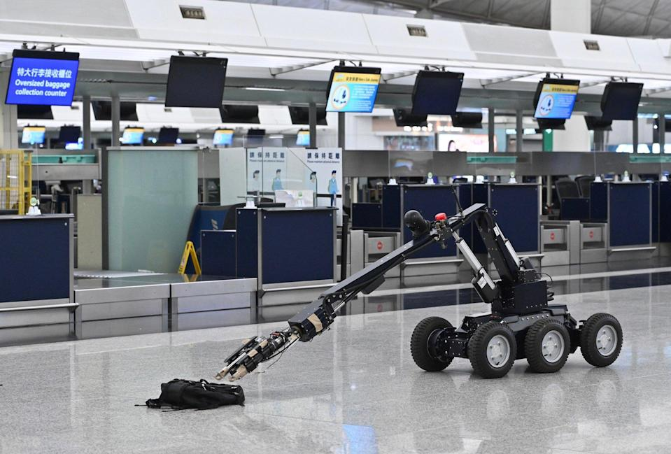 The Explosive Ordnance Disposal Bureau uses a robot to handle a suspicious bag in the departures hall. Photo: Handout