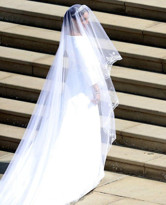 "<p>The white bateua gown was designed by British designer Clare Waight Keller, the artistic director of French fashion house Givenchy. Markle chose Clare because of her ""timeless and elegant aesthetic, impeccable tailoring, and relaxed demeanour,"" Kensington Palace said. (Photo: PA) </p>"