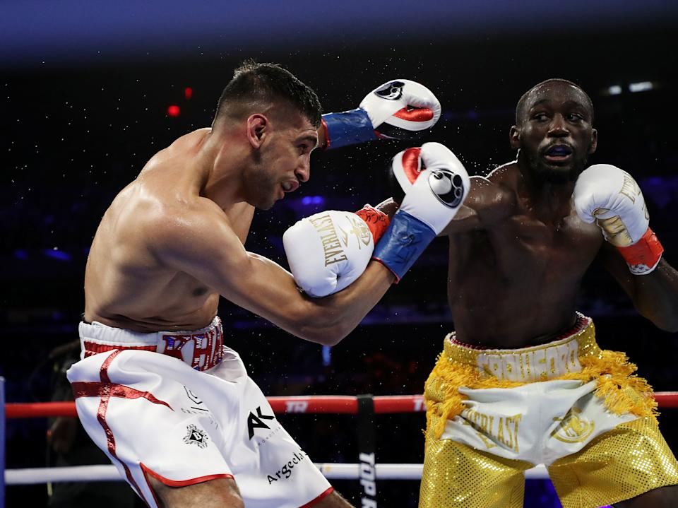 NEW YORK, NEW YORK - APRIL 20:  Terence Crawford punches Amir Khan  during their WBO welterweight title fight at Madison Square Garden on April 20, 2019 in New York City. (Photo by Al Bello/Getty Images)