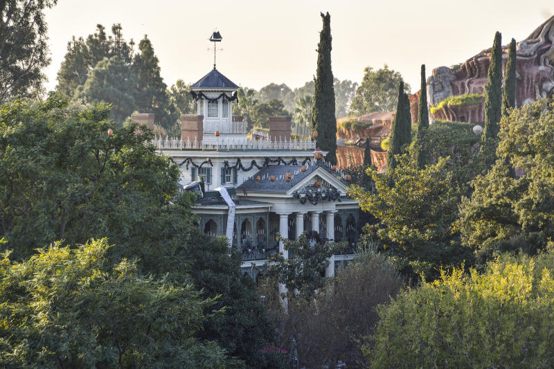 "ANAHEIM, CA - DECEMBER 14: Disneyland's Haunted Mansion seen from Tarzan's Treehouse in Anaheim, California, on Thursday, Dec 14, 2017. The Haunted Mansion. It was originally conceived to look spooky and dilapidated on the outside, but Walt Disney didn't want anything shabby in his park, so that plan was discarded. Designers first thought they would build a walk-through attraction, but later added the ""doom buggies"" to the design to improve traffic flow. (Photo by Jeff Gritchen/Digital First Media/Orange County Register via Getty Images)"