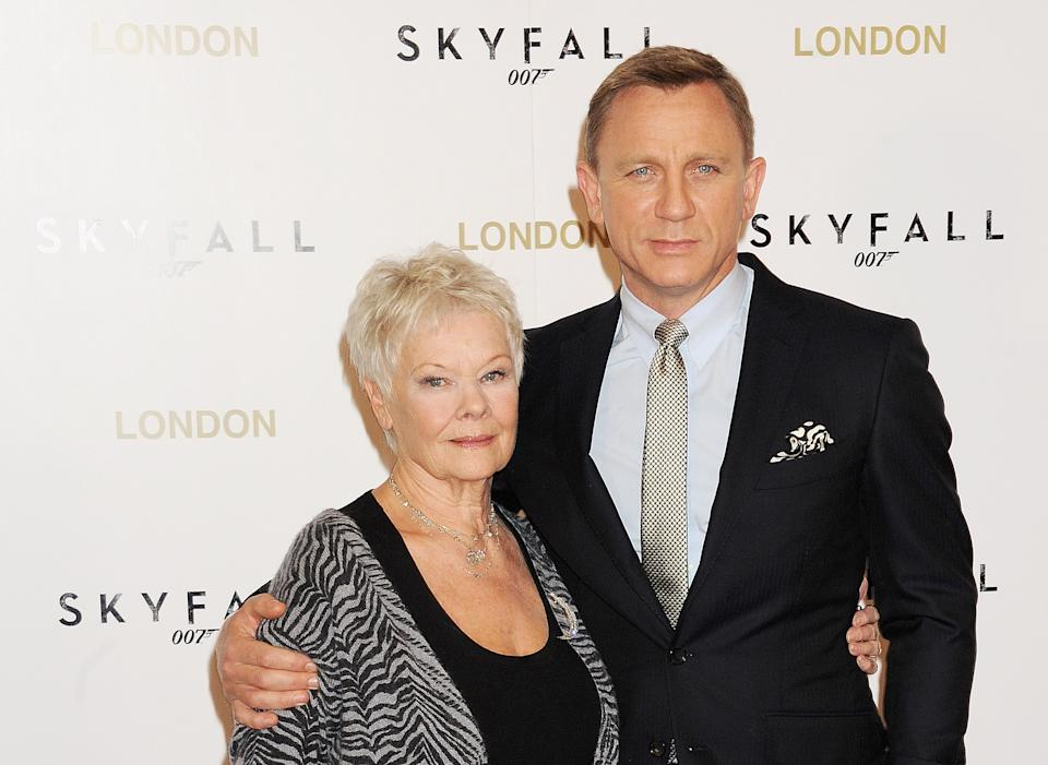 LONDON, ENGLAND - OCTOBER 22:  (EMBARGOED FOR PUBLICATION IN UK TABLOID NEWSPAPERS UNTIL 48 HOURS AFTER CREATE DATE AND TIME. MANDATORY CREDIT PHOTO BY DAVE M. BENETT/WIREIMAGE REQUIRED)   Dame Judi Dench (L) and Daniel Craig attend a photocall for the new James Bond film 'Skyfall' at The Dorchester on October 22, 2012 in London, England.  (Photo by Dave M. Benett/WireImage)