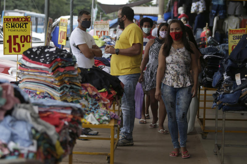 BRASILIA, May 25, 2020 -- People wearing face masks shop in Brasilia, Brazil, May 25, 2020. Brazil on Monday said its death toll from the novel coronavirus climbed to 23,473, following 807 fatalities in a single day. The total number of people who have tested positive for the disease reached 374,898, with a mortality rate of 6.3 percent, according to the Health Ministry. (Photo by Lucio Tavora/Xinhua via Getty) (Xinhua/ via Getty Images)