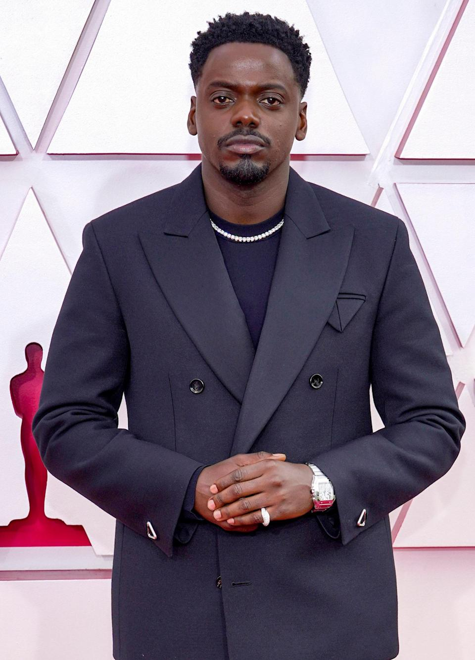 While his suit was classic and perfect for the occasion, Daniel Kaluuya's diamonds did most of the talking on the red carpet. His necklace, watch and pave pinky ring made for the perfect, bling-y accessories.