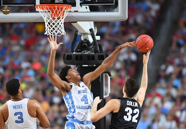 <p>North Carolina Tar Heels forward Isaiah Hicks (4) blocks the shot of Gonzaga Bulldogs forward Zach Collins (32) in the first half in the championship game of the 2017 NCAA Men's Final Four at University of Phoenix Stadium. Mandatory Credit: Bob Donnan-USA TODAY Sports </p>
