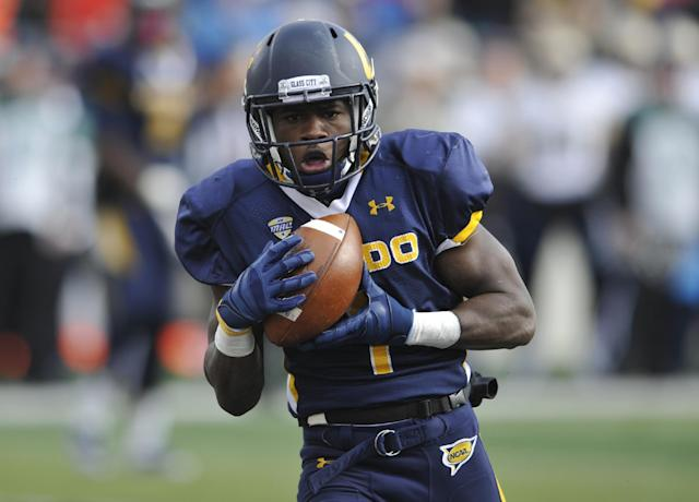 Toledo wide receiver Bernard Reedy catches a touchdown pass against Navy in the second overtime of an NCAA college football game in Toledo, Ohio, Saturday, Oct. 19, 2013. Toledo won 45-44 in double overtime. (AP Photo/David Richard)