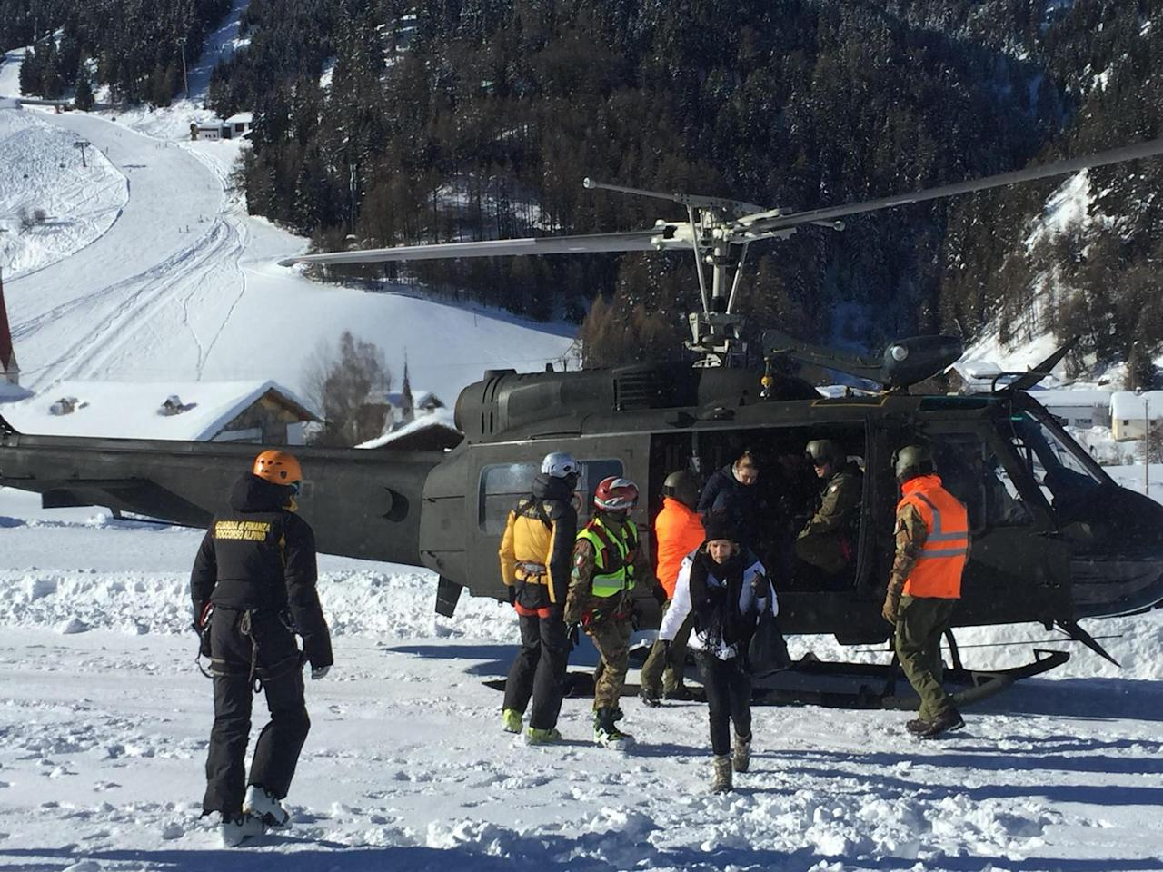 An Italian army helicopter lands during the evacuation of guests and tourists of the Langtauferer hotel in the Venosta valley, northern Italy, Tuesday, Jan. 23, 2018. About 75 tourists and hotel workers were being evacuated from a four-star mountainside hotel in northern Italy near the Austrian border after an avalanche overnight, the hotel manager said Tuesday as heavy snow caused disruption across the Alps. The Langtauferer Hotel, located near the Austrian border at 1,870 meters (6,135 feet) above sea level and some 100 kilometers (about 60 kilometers) northwest of Bolzano, was not directly hit, but was in an area of extremely high risk for further avalanches. (Italian Army via AP)