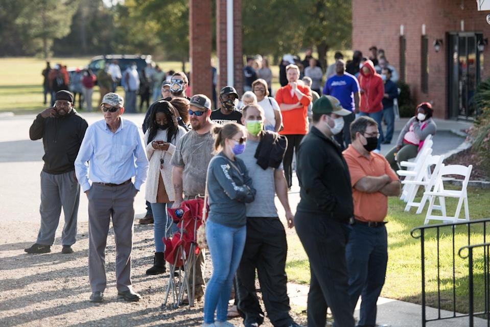 """<span class=""""caption"""">Will new election laws being proposed and passed in states limit people's opportunity to vote? </span> <span class=""""attribution""""><a class=""""link rapid-noclick-resp"""" href=""""https://www.gettyimages.com/detail/news-photo/voters-wait-in-line-to-cast-ballots-at-savannah-grove-news-photo/1229444017?adppopup=true"""" rel=""""nofollow noopener"""" target=""""_blank"""" data-ylk=""""slk:Sean Rayford/Getty Images""""> Sean Rayford/Getty Images</a></span>"""