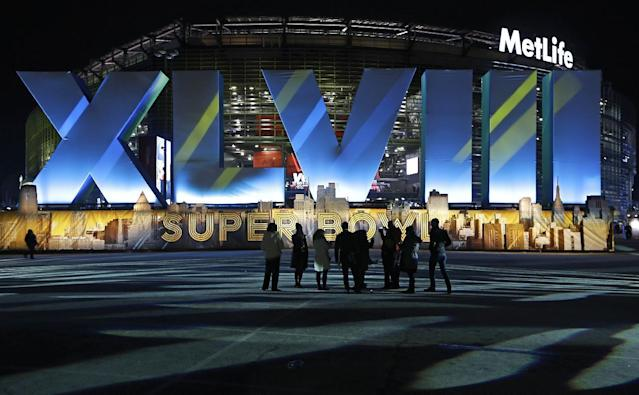 Fans walk near MetLife Stadium before the NFL Super Bowl XLVIII football game between the Seattle Seahawks and the Denver Broncos Sunday, Feb. 2, 2014, in East Rutherford, N.J. (AP Photo/Seth Wenig)