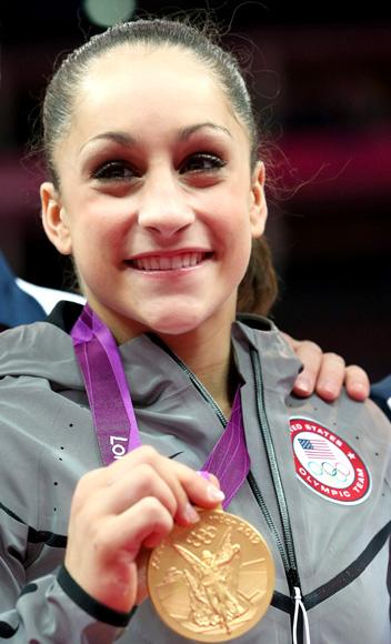 LONDON, ENGLAND - JULY 31:  Jordyn Wieber of the United States poses with the gold medal after helping the United States win the Artistic Gymnastics Women's Team final on Day 4 of the London 2012 Olympic Games at North Greenwich Arena on July 31, 2012 in London, England.  (Photo by Ronald Martinez/Getty Images)