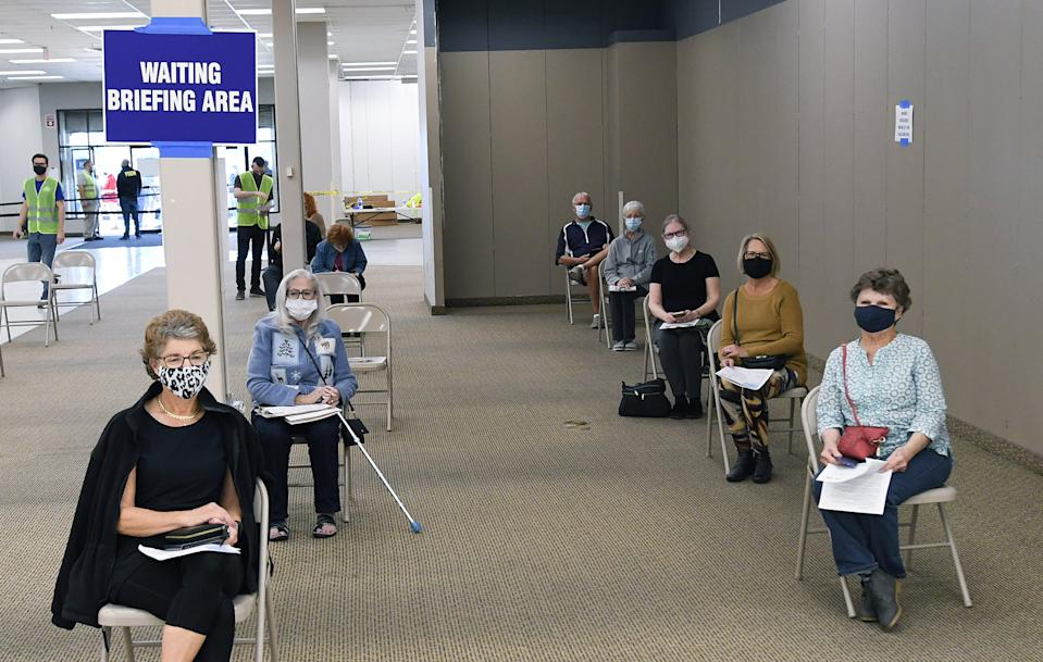 LEESBURG, FLORIDA, UNITED STATES - 2021/01/29: People wait to receive a shot of the Pfizer COVID-19 vaccine at a walk-in vaccination POD inside a vacant Sears store at the Lake Square Mall. The appointment-only site for frontline health care workers and seniors 65 and older is vaccinating around 700 people a day. (Photo by Paul Hennessy/SOPA Images/LightRocket via Getty Images)