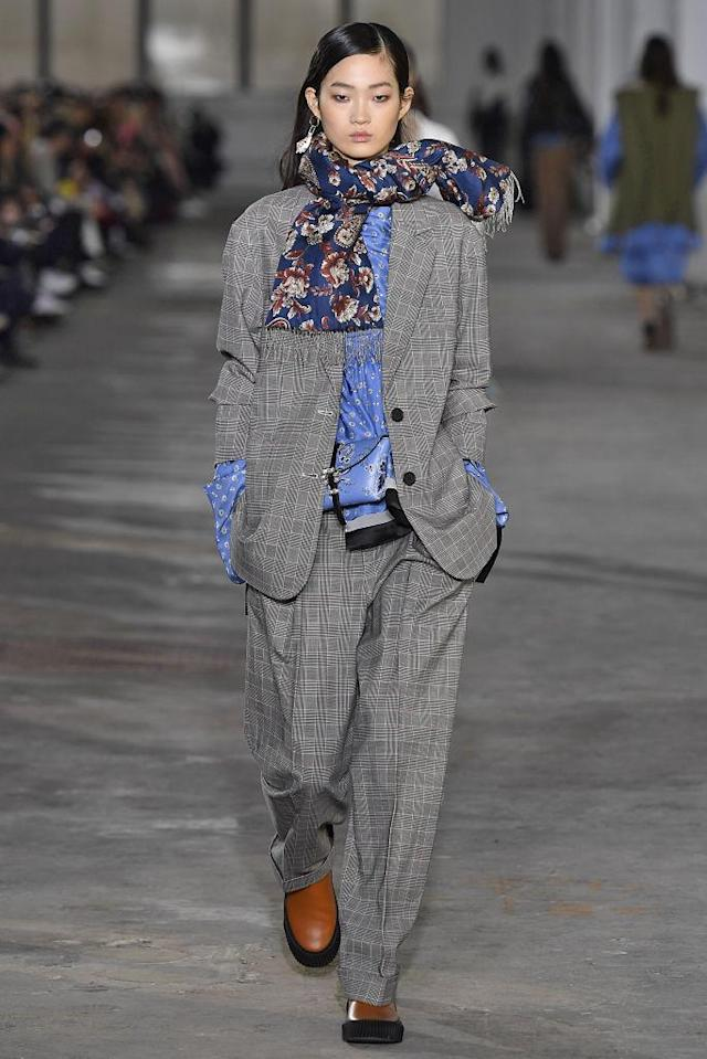 <p>Model wears a gray pantsuit at the fall 2018 3.1 Phillip Lim show. (Photo: Getty Images) </p>