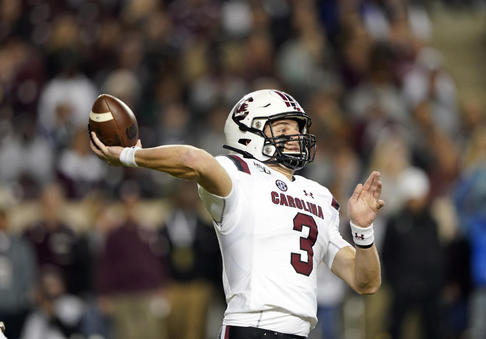 FILE - South Carolina quarterback Ryan Hilinski (3) throws a pass against Texas A&M during the first quarter of an NCAA college football game Saturday, Nov. 16, 2019, in College Station, Texas. South Carolina and coach Will Muschamp haven't had a true quarterback competition since 2016 _ and he's taking much of the way through camp as Ryan Hilinski, Collin Hill and Luke Doty try to become the Gamecocks' passer. (AP Photo/David J. Phillip, File)