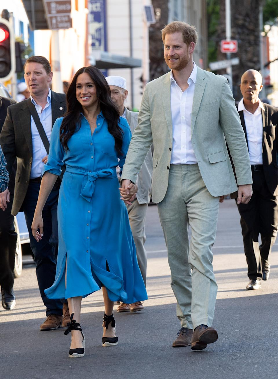 The Duke visited District 6 in Cape Town wearing a grey two-piece suit from J.Crew, a white button-down shirt and chocolate brown shoes. [Photo: Getty Images]