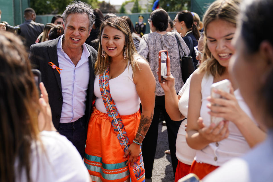 Mark Ruffalo meets with young people from the Rosebud Sioux Tribe after a ceremony at the U.S. Army's Carlisle Barracks, in Carlisle, Pa., Wednesday, July 14, 2021. The disinterred remains of nine Native American children who died more than a century ago while attending a government-run school in Pennsylvania were headed home to Rosebud Sioux tribal lands in South Dakota on Wednesday after a ceremony returning them to relatives. (AP Photo/Matt Rourke)