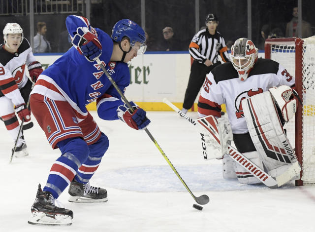 New York Rangers left wing Jimmy Vesey (26) skates in on New Jersey Devils goaltender Cory Schneider (35) during the second period of an NHL hockey game Saturday, Feb. 23, 2019, at Madison Square Garden in New York. (AP Photo/ Bill Kostroun)