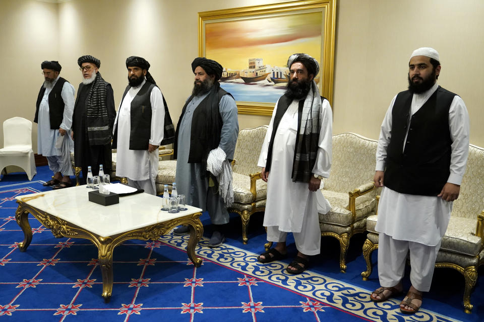 FILE - In this Nov. 21, 2020, file photo, members of the Taliban's peace negotiation team meet with Secretary of State Mike Pompeo amid talks between the Taliban and the Afghan government, in Doha, Qatar. On Jan. 31, 2021, Rasul Talib, a member of the Afghan government's peace negotiating team warned the Taliban that if they don't resume peace talks in Qatar soon, the government could recall the team before a deal is reached. Talib said in a press conference that the team is waiting for the return of the Taliban leadership, where a second round of peace talks began this month but has made little progress. (AP Photo/Patrick Semansky, Pool), File