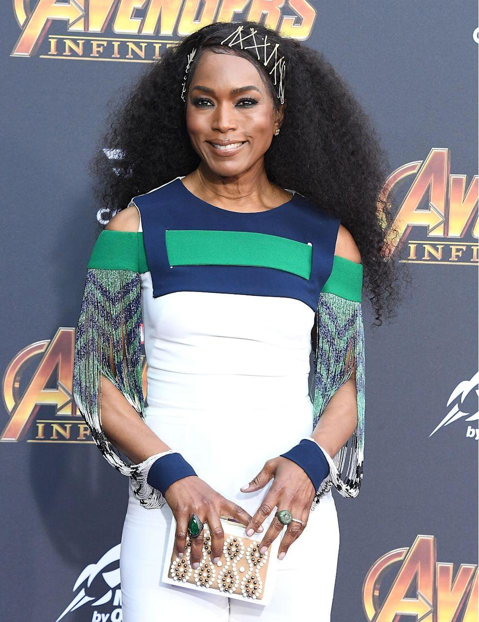 <p>Use multiple bobby pins to keep curls out of your face and look avant-garde stylish at the same time, like actress Angela Bassett. </p>