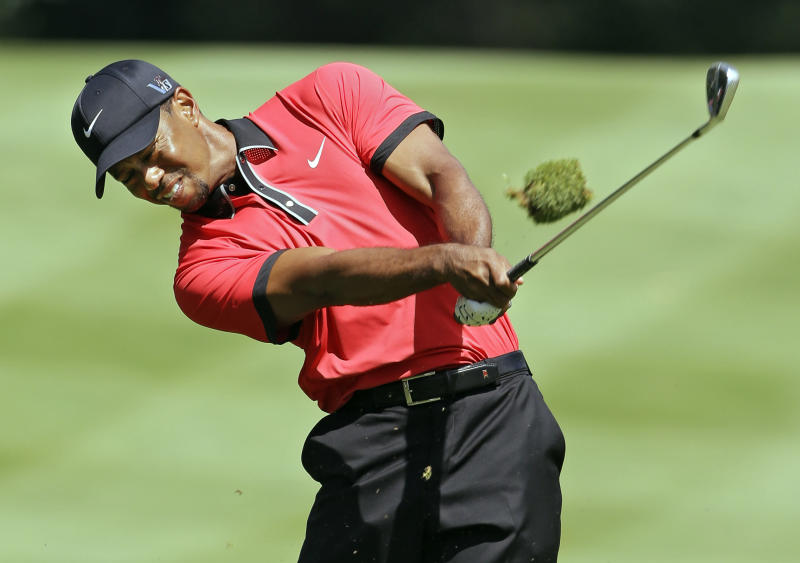 Tiger Woods hits to the sixth green during the final round of the Bridgestone Invitational golf tournament Sunday, Aug. 4, 2013 at Firestone Country Club in Akron, Ohio. (AP Photo/Mark Duncan)